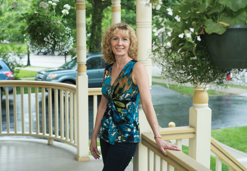 Jerri Coffey posing on a front porch